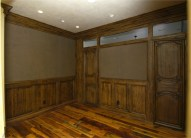 Heavily distressed rustic alder library-office with barn wood floors