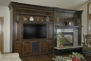 Dark walnut wall unit for AV, fireplace and display