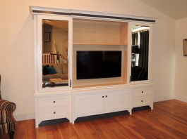 White lacquered TV cabinet with sliding doors
