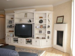 White lacquered wall unit with storage for TV Media and display items.