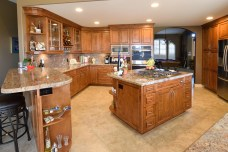 Full overlay maple wood cabinets with center island