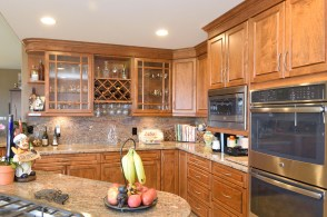 Full overlay maple wood cabinets with upper diagonal and base lazy susan cabinets