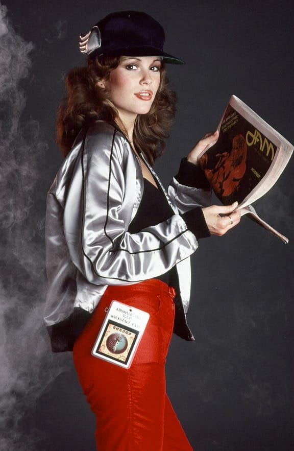 Candy Loving, Playboy's 25th Anniversary Playmate holding the November 1979 issue of JAM Magazine - issue #3