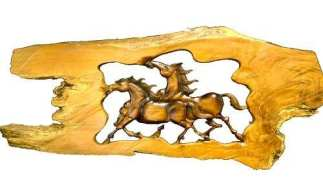 Carving of Two Running Horses