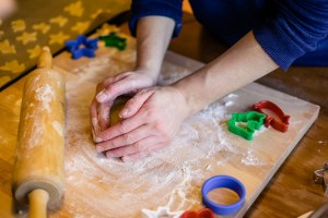 Caucasian person's hands kneading cookie dough