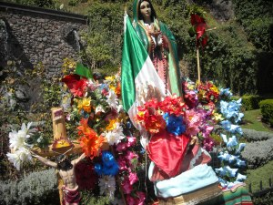 Our Lady of Guadalupe statue surrounded by flowers