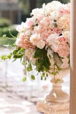 Pink Hydrangeas, Roses and Eucalyptus Filled Urns – shared on Elizabeth Anne Designs