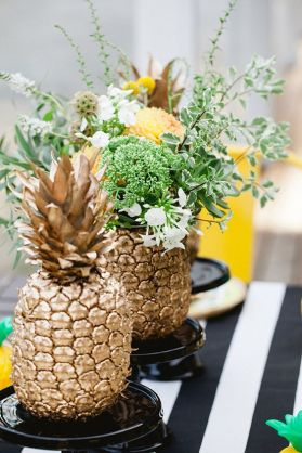Golden Pineapple with Black and White Stripes Tablescape – shared by Better Homes and Gardens