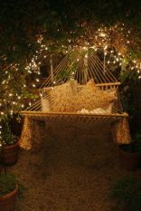 Hammock Swing Surrounded by Vines and Fairy Lights