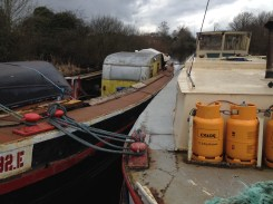 Yes, that is a caravan inside a barge...!