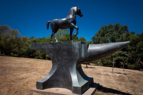 A horse on an anvil. It must mean something.