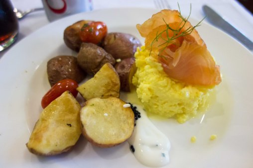 Breakfast--scrambled eggs, roasted potatoes and smoked salmon