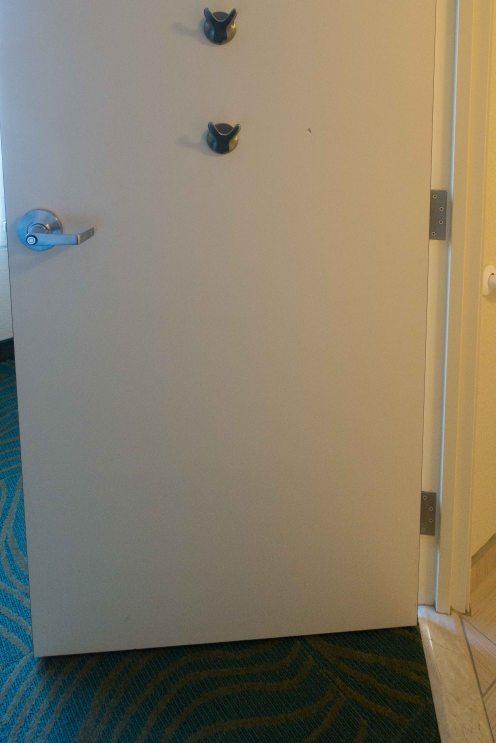 High and low robe/towel hooks on the bathroom door