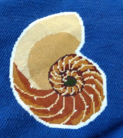 Embroidered image of a shell