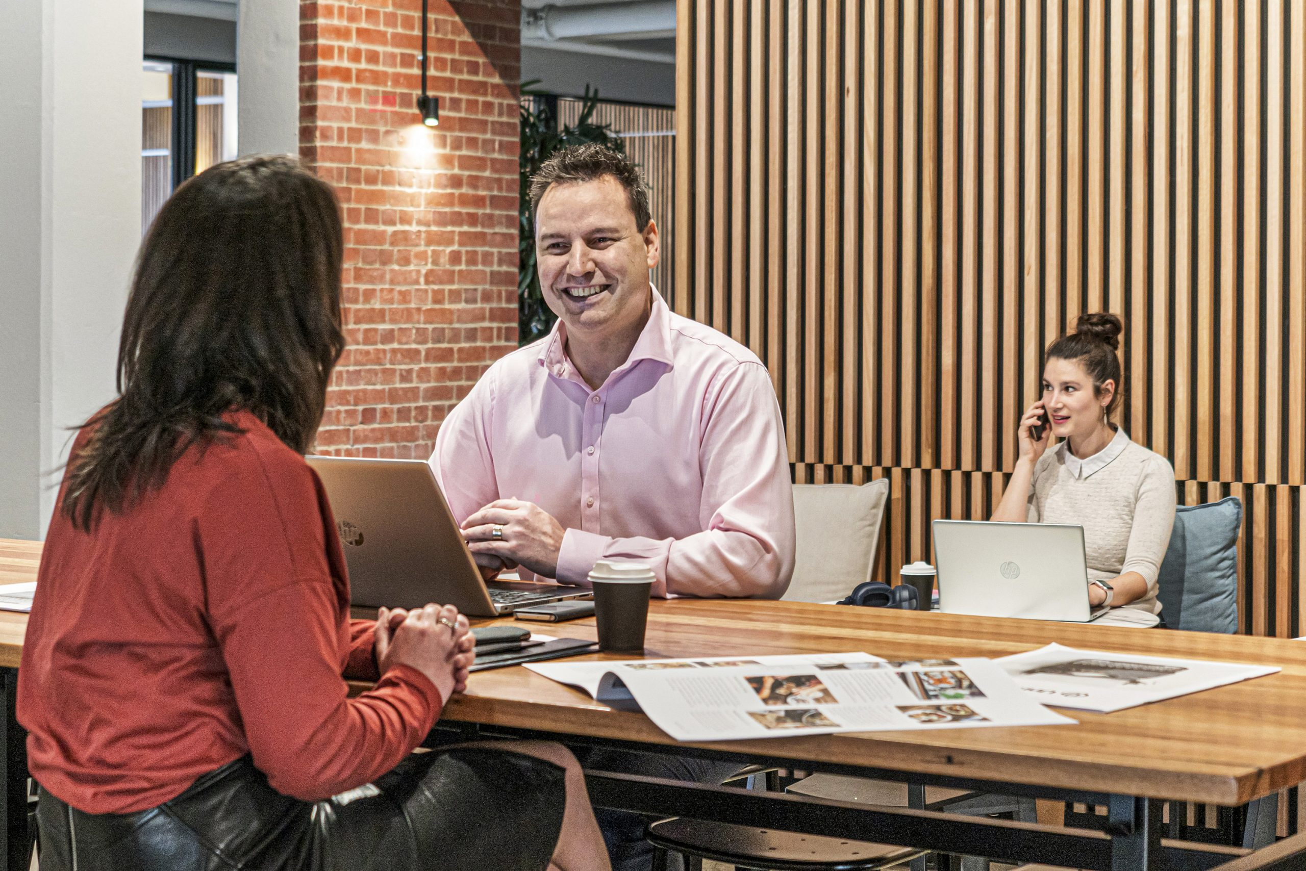 3 people working in a coworking space