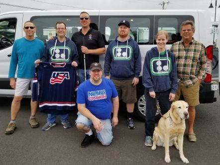 Members of the Hartford Braillers boarding the van from Connecticut to the Blind Hockey Summit in Pittsburgh in October 2019. L-R Todd Sweet, Keith Haley, Jim Sadecki, Joel Klug, Liz Bottner with guide dog Dalton (ret) and volunteer Chauffeur Kent Hayles. Front: Frank Roberts