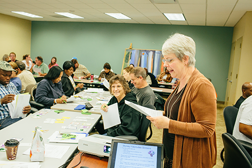 A volunteer financial educator conducts a free workshop at RealSense Prosperity Place.