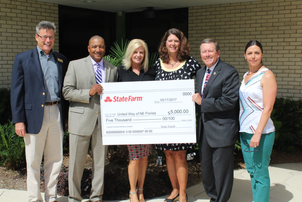City Councilman Jim Love, Edie Williams and Joe McGhee, State Farm agents present the grant check to several members of United Way of Northeast Florida leadership team. (Not Pictured: Joy Atkins)