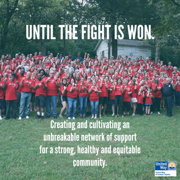 """Group photo of 2019 Day of Caring volunteers in their red shirts. The words """"Until the fight is won. Creating and cultivating an unbreakable network of support for a strong, healthy and equitable community"""" are superimposed in white at the top and bottom."""