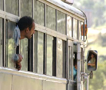 A passenger heading for Dhulikhel looks outside with full of curiosity about the incident as the vehicle arrives at the clash site.