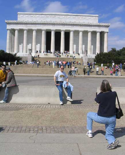 Tourists taking photos in front of lincoln memorial