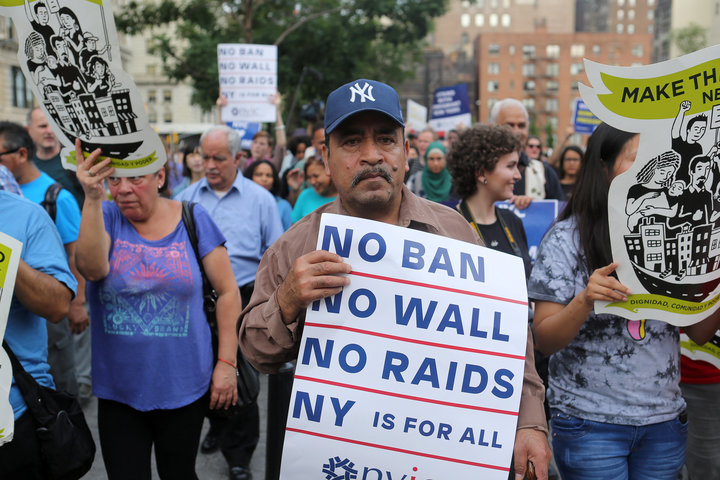 Protesters chant slogans and hold signs against U.S. President Donald Trump's limited travel ban, approved by the U.S. Supreme Court, in New York City