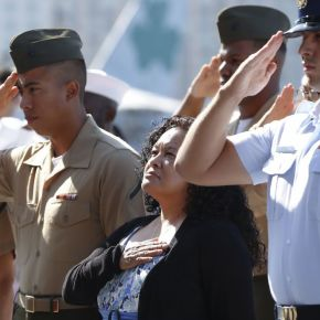 Military personnel and relatives take citizenship oath on USS Midway Museum in San Diego