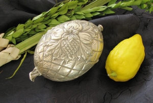 From the left: Lulav (palm branch), Etrog (citron) and Etrog case used for Sukkot.
