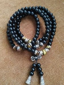 Bracelet Mala de protection Bouddhiste en obsidienne et œil de tigre photo review