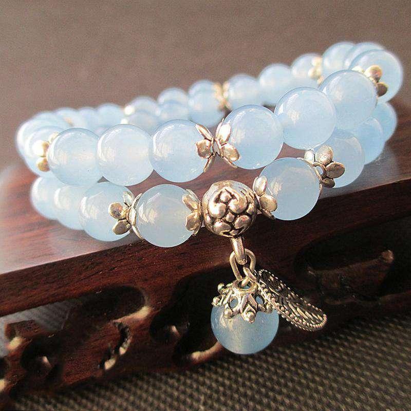 Bracelet Tibétain en perles de Jade bleu avec Pendentif en feuille d'Argent - L'univers-karma