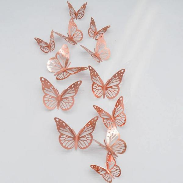 stickers papillon rose sur un murs blanc
