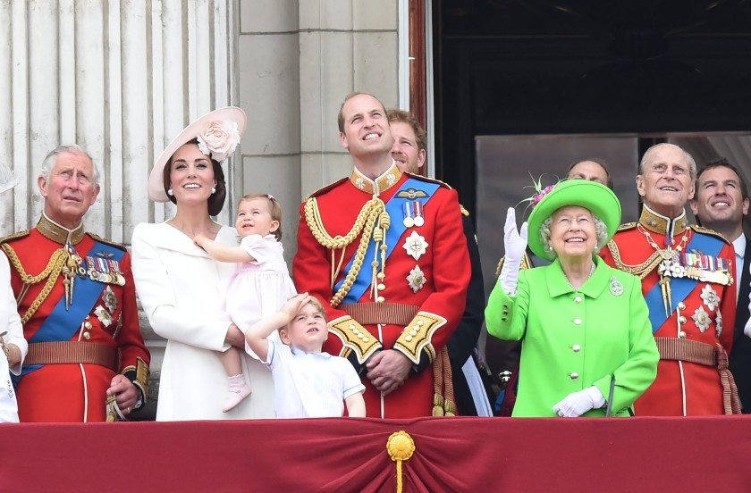The Duchess of Cambridge, Kate, with Princess Charlotte in her arms, Prince George, Prince William, Queen Elizabeth II and Prince Philippe enjoy the air show from the balcony of Buckingham Palace