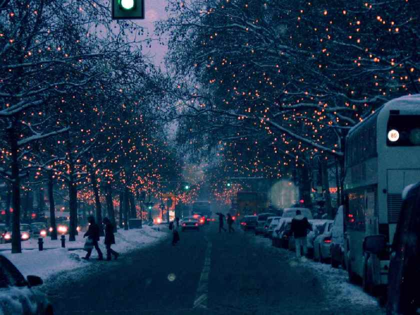 A beautiful Street with christmas decorations, everything calm, people are out in snowy streets happyly. This is  one of the best short inspirational Christmas stories