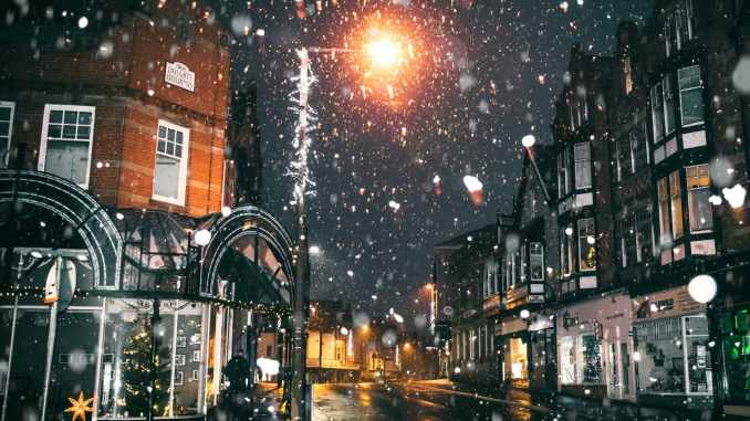 rain of snow in town painting in christmas