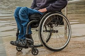 Wheelchair User At Waters Edge in the UK