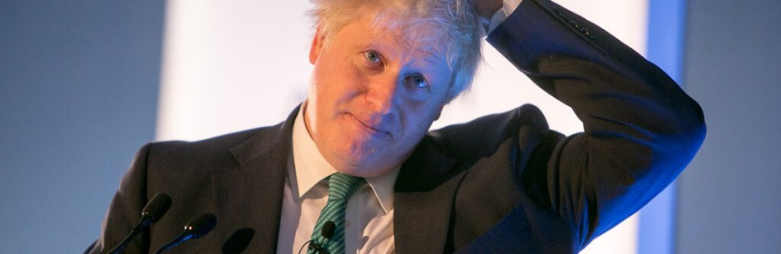 Boris Johnson standing at a lecturn