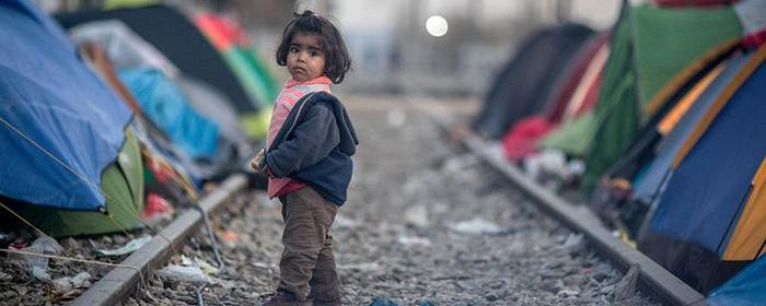 An unaccompanied child refugee on train tracks