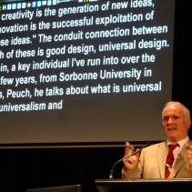 Dr Ger Craddock speaking at the Australian UD Conference in 2014 showing the live captioning screen