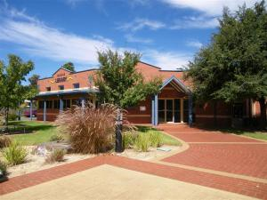 Library building with wide level paved pathway to the entrance. Picture taken in Berrigan NSW.