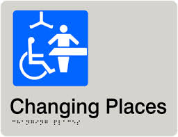 Blue and white toilet sign indicating a large change table and hoist