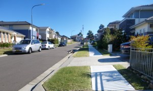New housing development showing narrow footpath and nature strip.