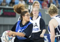 Picture of young women on a netball court.