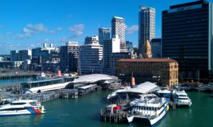 View of Auckland cityscape and waterfront with piers and boats
