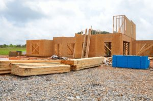 new home construction site with timber on the ground.