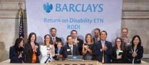 A group of people with a Barclays Bank banner behind them