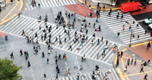 Birds eye view of a wide pedestrian crossing with lots of people on it
