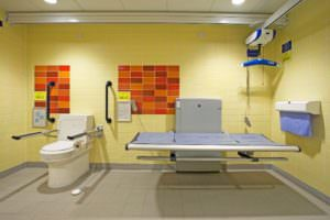 changing places toilet showing a large change table and hoist