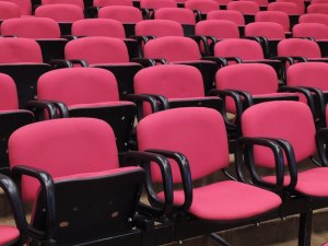 bright pink seating in an auditorium
