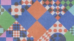 An abstract pattern of muted blue and orange squares of different sizes.