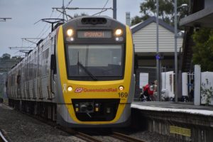 Front view of a Queensland Rail train at a station. It says Ipswich on the LED display